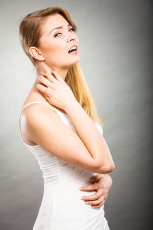 atopic: Health problem, skin diseases. Young woman scratching her itchy neck with allergy rash