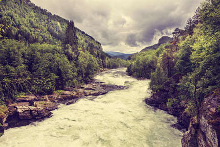 rapidly: The rapidly flowing Stranda river winding through mountains, beautuful canyon in Norway.