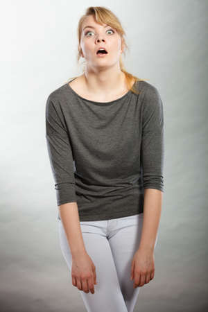 disbelief: Shock and disbelief concept. Surprised astonished girl with wide open mouth. Amazed female looking very shocked. Facial expression and body language.