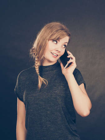keep in touch: Flirt and romance. Begin of relatinship. Attractive blonde woman flirting texting on mobile phone smartphone. Gorgeous girl keep in touch with her lover by messages and calls.