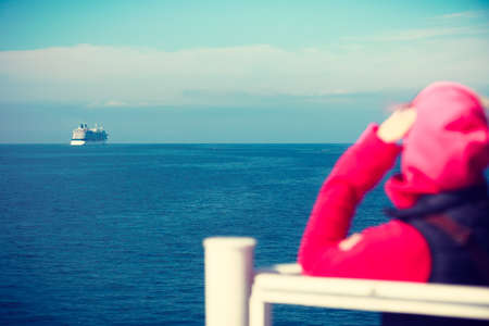 hirtshals: Travel holiday and tourism. Tourist woman on cruise ship boat enjoying open ocean view, seascape background Stock Photo