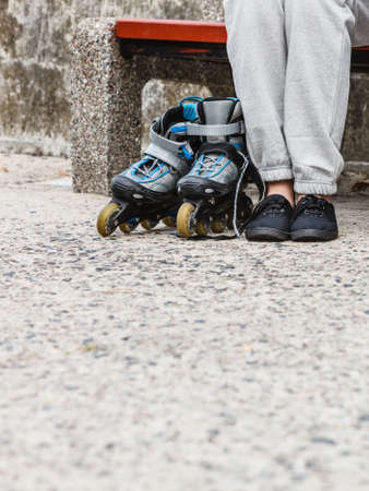 roller blade: Closeup of woman girl with roller skates blades outdoor.
