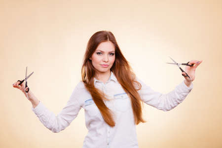 craze: Craziness of professional hairdresser. Hair hygiene. Girl with scissors making crazy funny face preparing herself to cutting styling new image hairdo coiffure.