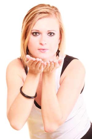 Gesture, flirt, coquet concept. Beautiful blonde woman sending air kiss. Studio shot, isolated.