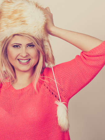 seasonal clothes: Clothing accessories, seasonal clothes concept. Woman wearing red jumper and winter furry warm hat Stock Photo