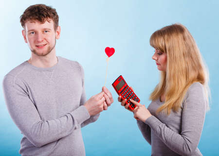 Advantages and disadvantages of relationship. Young blonde attractive lady calculate percentage provision of being girlfriend.