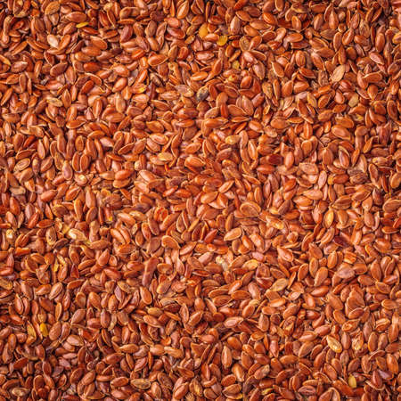 cathartic: Healthy diet organic nutrition. Brown raw flax seeds linseed as natural food background Stock Photo