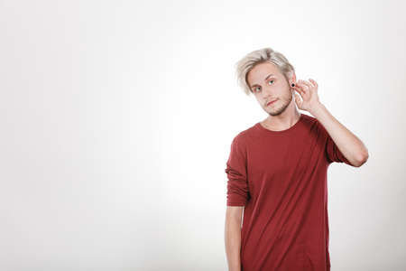 highlighted hair: Handsome young fashion model with colored hair highlighted stylish haircut