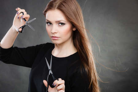 professionalist: Elegance and classy. Fashion style of hairdo. Female professionalist with scissors. Elegant woman presents her hairdressers saloon.