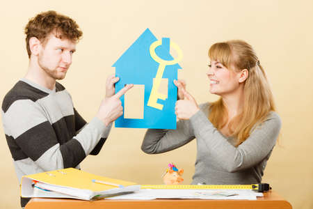Dreaming and buying house. Disagreement concept. Young couple pair have different opinion about their first real estate.