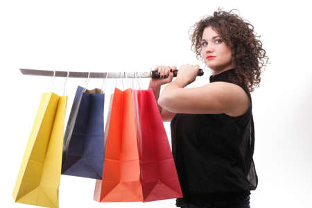 lovely woman with shopping bags and sword over white photo
