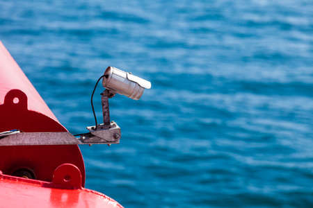 CCTV security camera on deck of cruise ship, video surveillance