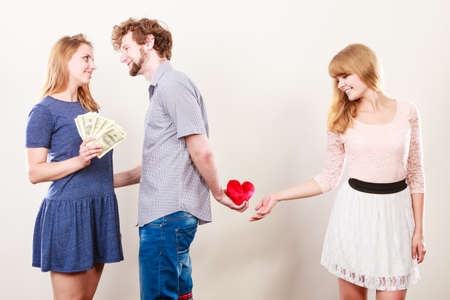 Cheating and cunning idea. Handsome sneaky man tricking rich woman for his true love. Triangle concept. Stock Photo