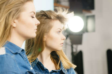 Two beautiful young blonde women having serious face expression. Feminine beauty portrait concept. Stock Photo