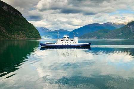 Tourism vacation and travel. Mountains landscape and ferryboat sailing on fjord in Norway Scandinavia Europe. Norddalsfjorden as seen from ferry. Beautiful nature Stock Photo
