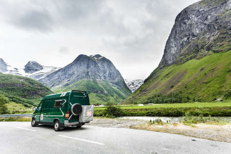 campervan: Tourism vacation and travel. Camper van and norwegian mountains landscape Stock Photo