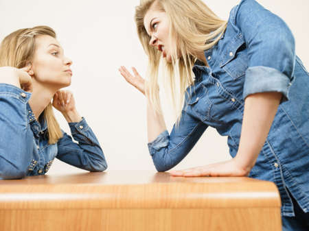 celos: Two women having argue mocking up being mad at each other. Female telling off, ignorance concept.