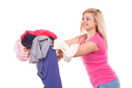 Household duties, domestic chores concept. Woman having a lot of colorful clothes to iron Stock Photo