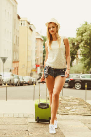 Young blonde woman with luggage