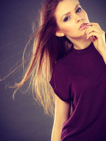 Glamour and beauty. Portrait of gorgeous glamorous fashionable woman with long straight dark hair waving. Stunning young elegant lady. Stock Photo