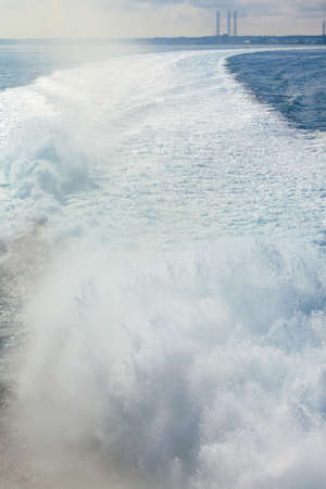 Sea and kielwater seen from ship, trail on the water after the ferry sail, wake of boat. Stock Photo