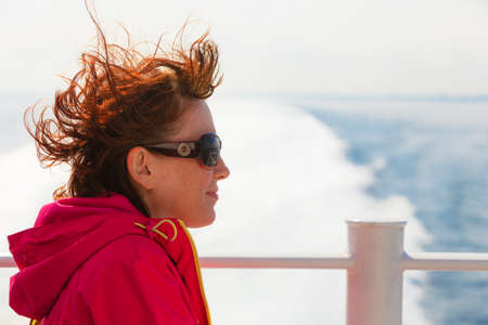 Travel holiday and tourism. Tourist woman on cruise ship boat enjoying open ocean view, seascape background Stock Photo