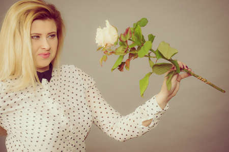 Happy positive woman holding white roses. Valentines and womans day gift ideas concept.