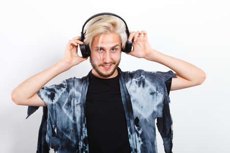 Young people, happiness and leisure concept. Passionate music lover joyful stylish guy with headphones listening music, relaxing enjyoing Stock fotó