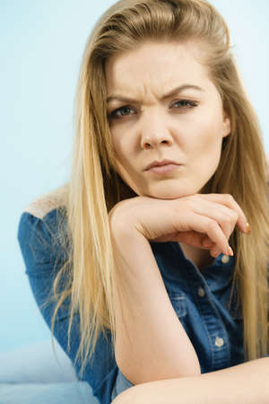 Woman being uncertainty skeptical questioning something and gesturing having thinking face expression.