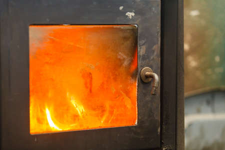 Mechanical metallurgy fixing engineering industry concept. Steel furnace in operation. Hot industrial stove full of fire.