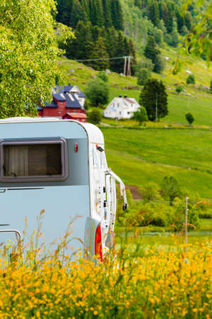 Tourism vacation and travel. Camper van and norwegian mountains landscape Stock Photo