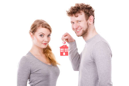 Housing security family love romance furute planning finances concept. Couple with house keys. Man with lady holding home pendant keyring.