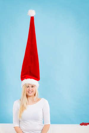 gasping: Happy woman gasping having crazy long windblown santa hat in funny way.