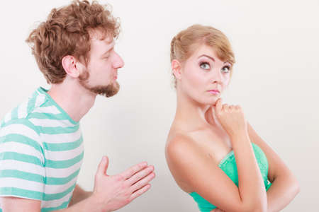Conflicted couple. Relationship problem. Boyfriend trying to convince girlfriend. Man asking for forgivness. Husband apologizing wife. Unhappy, upset, angry woman refuses apology.