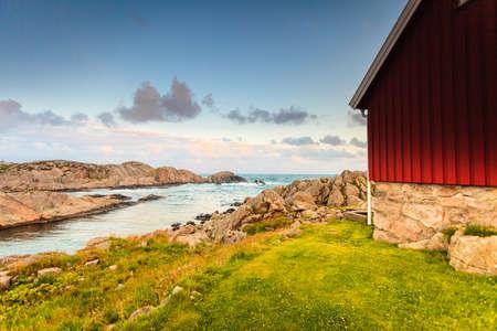 Houses along coastline near Lindesnes lighthouse, South Cape, Vest-Agder, Norway