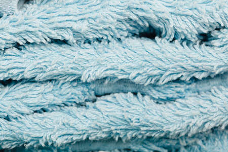 Detailed closeup of blue towel fabric surface. Patterns, textures and background concept.