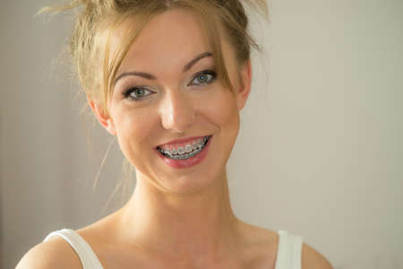 Happiness human face expressions concept. Happy positive cheerful smiling woman with blonde hair tied in bow