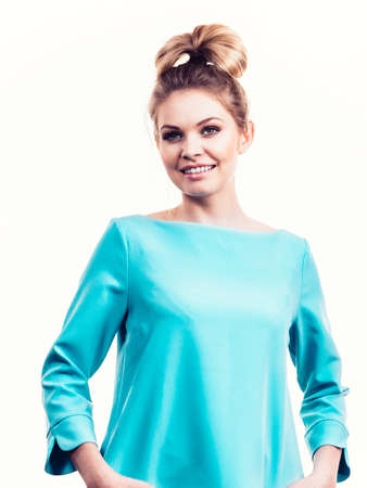 Happy adult woman presenting her casual beautiful outfit, long sleeved blue top. Stock Photo
