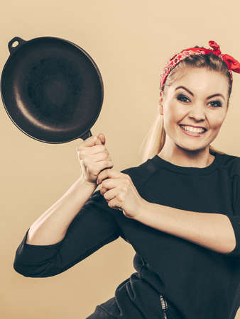 Joy and fun during food preparation. Blonde smiling woman in retro style having fun in kitchen. Playful girl with accessories of cooking. Фото со стока - 114656894