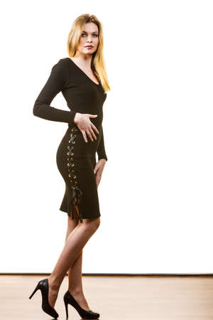 Pretty beautiful woman wearing stylish short black dress. Teenage presenting elegant outfit.