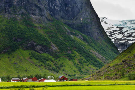 Tourism vacation and travel. Mountains landscape at summer with beautiful grren valley, Stryn municipality in the county of Sogn og Fjordanein Norway, Scandinavia. Stock Photo