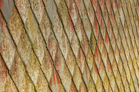 Brown stone tiles roof texture architecture background seamless pattern, detail of house close up Stock Photo