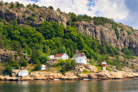 Beautiful seascape norwegian coastline, coast of Kristiansand with small lighthouse, Scandinavia Europe. Reklamní fotografie