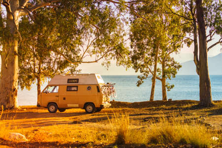 Tourism vacation and travel. Camper van on beach seashore in Greece Stock Photo