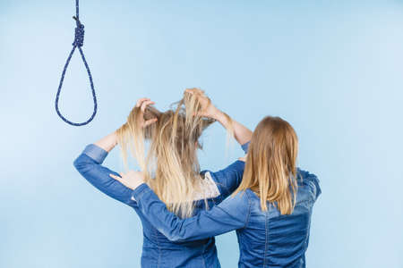 Woman trying to help her best friend with suicidal thoughts. Friendship and depression concept. Stock Photo - 105614408