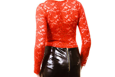 Adult blonde pretty woman wearing seductive outfit, leather latex slim skirt and red lace top.