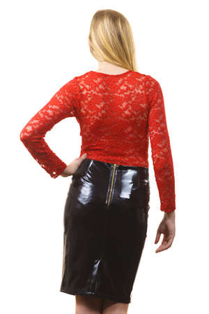 Sexy adult blonde pretty woman wearing seductive outfit, leather latex slim skirt and red lace top.