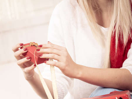Holiday gifts, seasonal celebration and crafting concept. Unrecognizable woman hands opening christmas presents