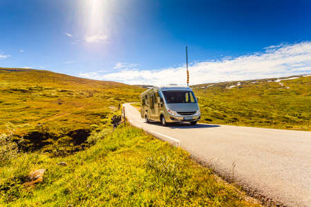 Tourism vacation and travel. Camper van on road, summer mountains landscape. National tourist route Aurlandsfjellet.