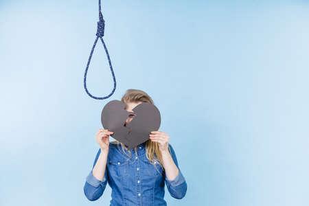 Sad depressed woman thinking about suicide after having broken heart. Relationship breakup problem, depression concept.